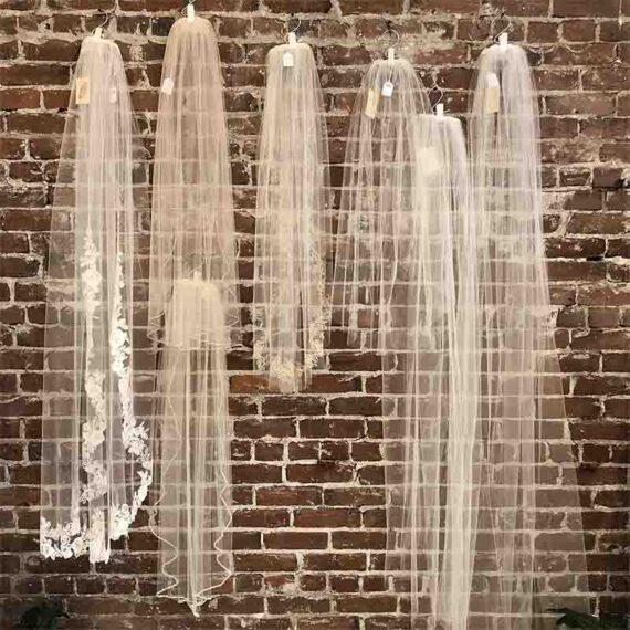 wedding veils hanging on display