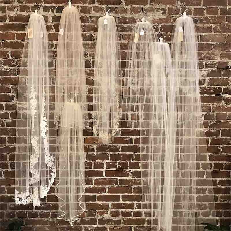 wedding veils hanging on display